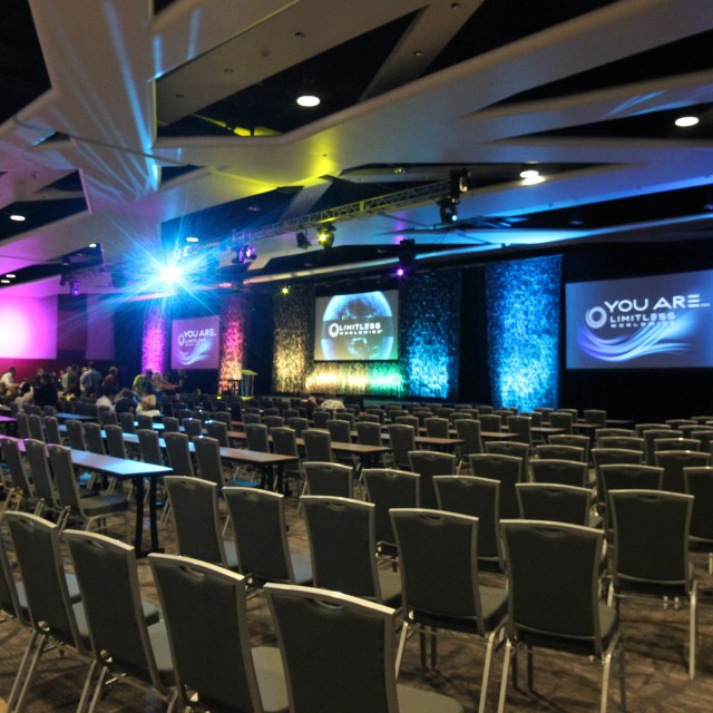 Large ballroom with seats facing large projection screens