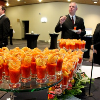 An hors d'oeurve buffet with shrimp in small glasses