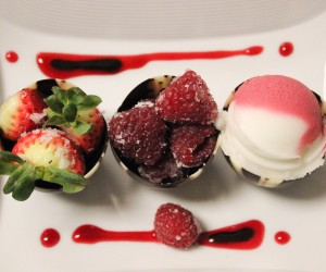 3 chocolate cups with strawberries, raspberries and sherbet