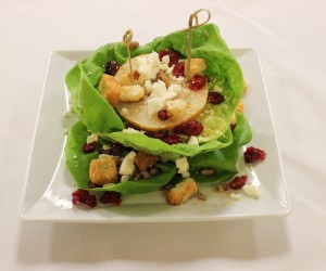 Stacked green salad with Asian pear and other toppings